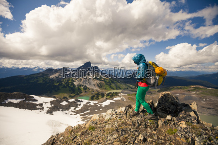 a young woman hiking on panorama