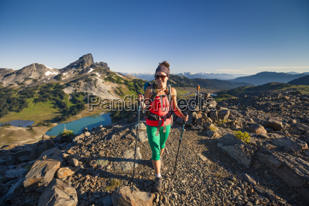 a young woman hiking on the