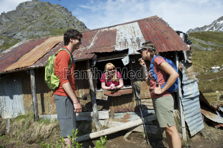 hikers stop at an old shack