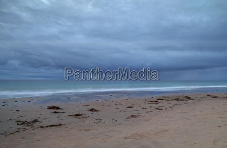 rain clouds approach crystal cove beach