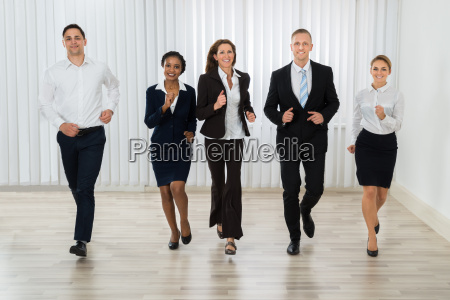 businesspeople together running in office