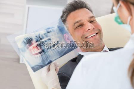 dentist with teeth x ray in