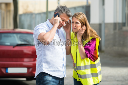 couple using mobile phone with broken
