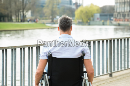 rear view of disabled man on