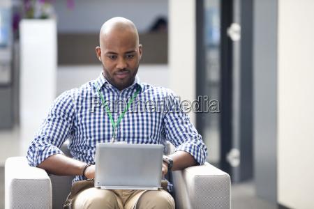 portrait of man working on digital