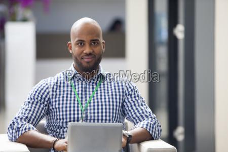 portrait of male office worker looking