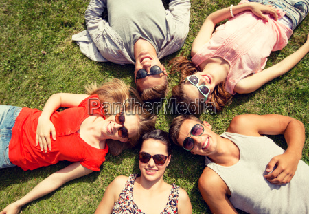 group of smiling friends lying on