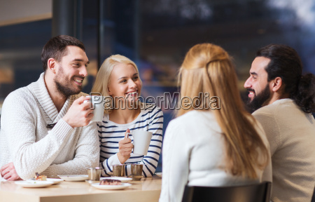 happy friends meeting and drinking tea