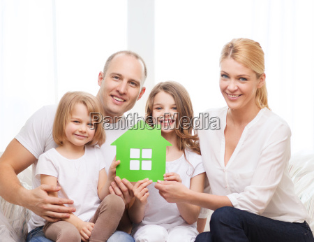 smiling parents and two little girls