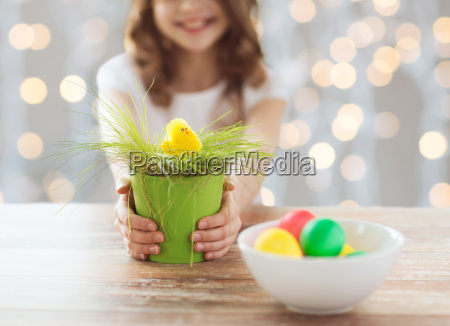 close up of girl holding pot