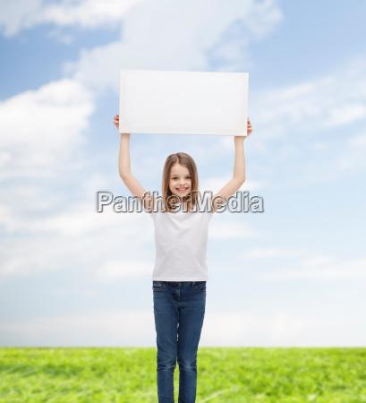smiling little girl holding blank white