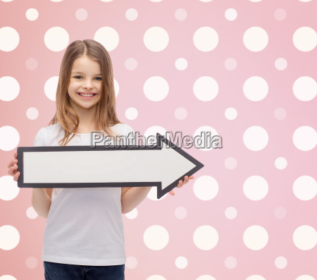 smiling girl with blank arrow pointing