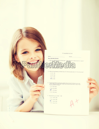 girl with test and grade at