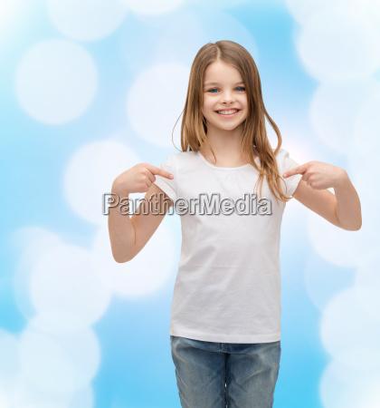 smiling little girl in blank white