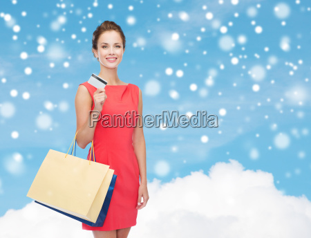 smiling woman with shopping bags and