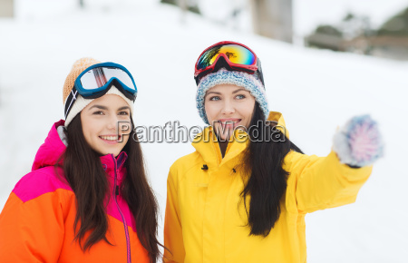 happy girl friends in ski goggles