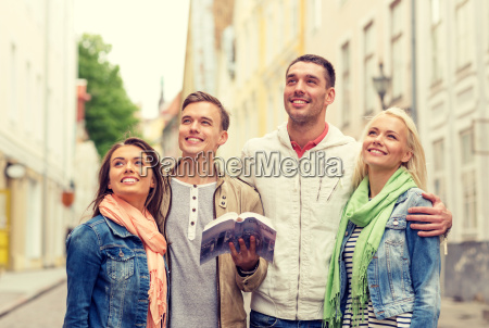 group of friends with city guide