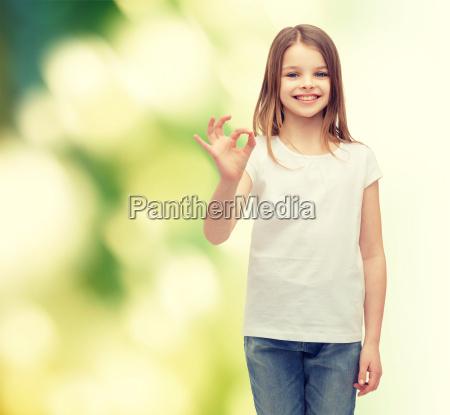 little girl in white t shirt
