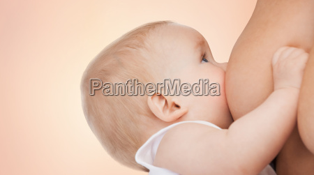 close up of mother breast feeding