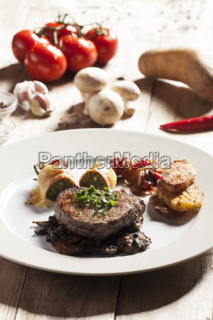 steak with ingredients on wood