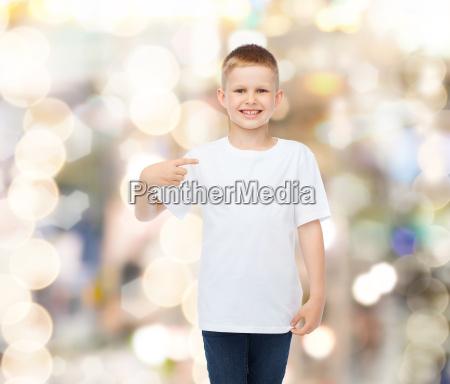 smiling little boy in white blank