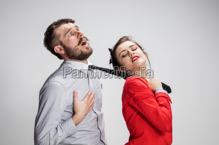 woman leading a man by his