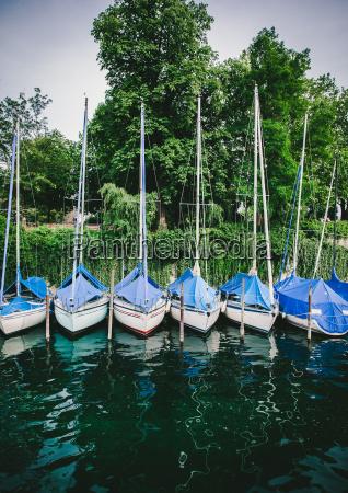 sailing and fishing boats moored ashore