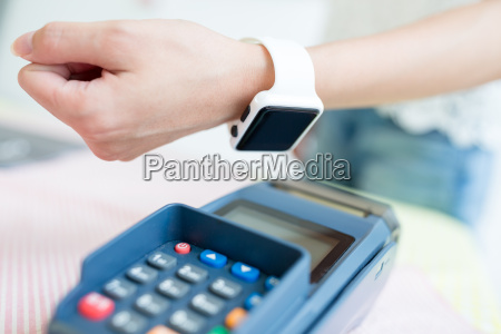 customer paying with nfc technology with
