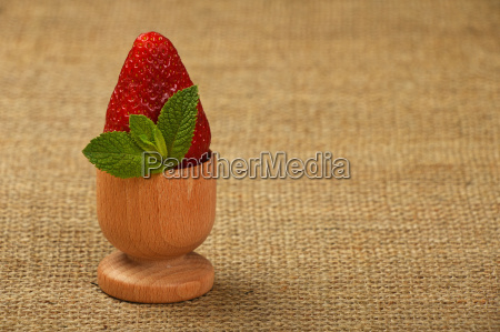 strawberry and mint leaves in eggcup