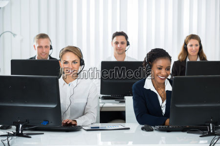 call center operators working on computers