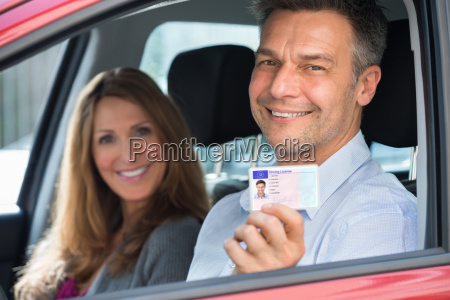 man sitting inside the car showing