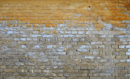 old grunge brick wall with paint