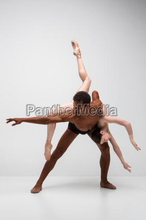 couple of ballet dancers posing over