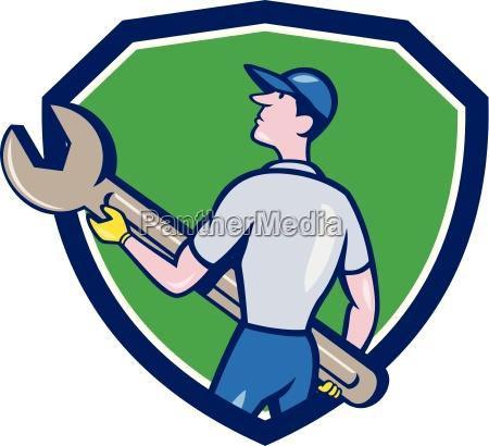 mechanic carrying giant spanner crest cartoon