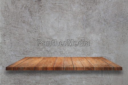 top wooden table on gray concrete