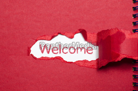 the word welcome appearing behind torn