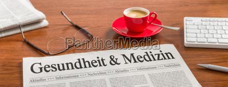 newspaper on desk health and