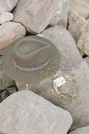 a wide brimmed hat and jewellery