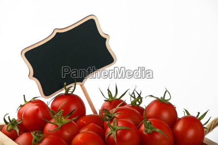 red tomatoes with price sign over