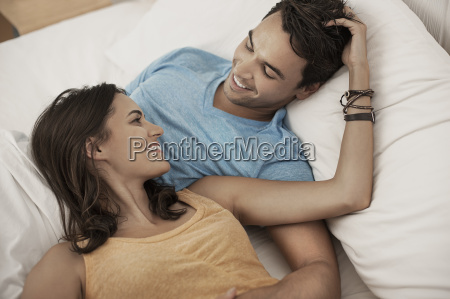 a young couple lying on a