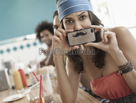 a woman holding a picture of