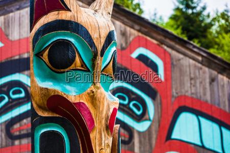 totem pole near saxman tribal house