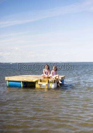 two sisters on floating dock in
