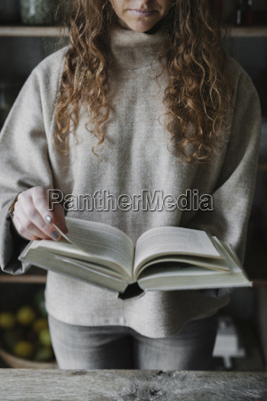 a woman reading from a recipe