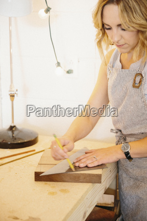 a woman in her workshop using