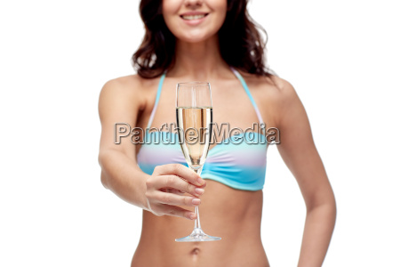 happy young woman in swimsuit drinking