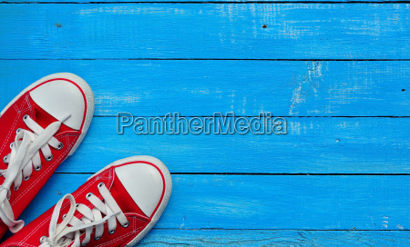 red sneakers on a blue background