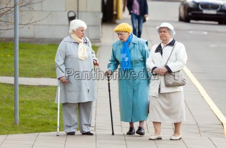 aged senior women walking on the