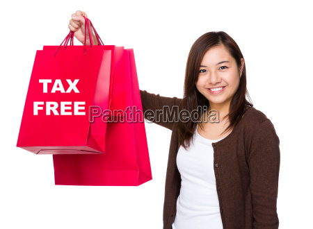 asian woman holding with shopping bag
