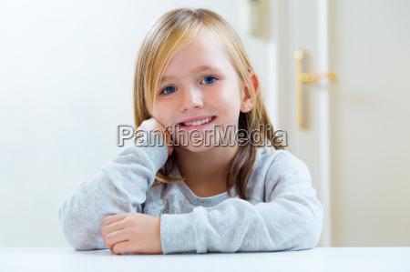 beautiful blonde child sitting at a